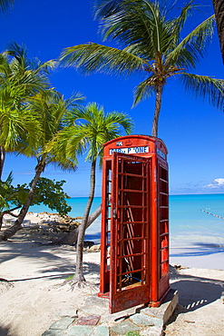 Beach and red telephone box, Dickenson Bay, St. Georges, Antigua, Leeward Islands, West Indies, Caribbean, Central America