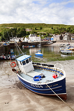 Beached fishing boat in the Harbour at Stonehaven, Aberdeenshire, Scotland, United Kingdom, Europe