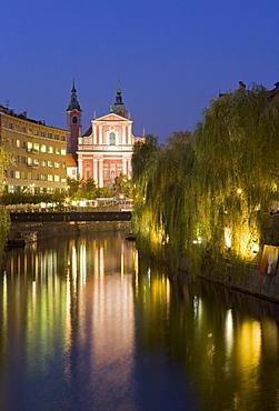 The Church of the Annunciation on the Ljubljanica River at dusk, Ljubljana, Slovenia, Europe