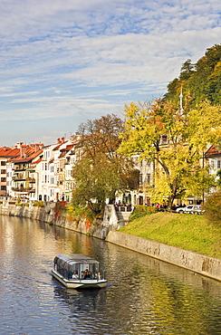 River cruise boat on the Ljubljanica River in autumn, Ljubljana, Slovenia, Europe