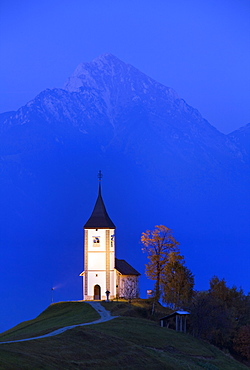 The floodlit church of St. Primoz at dusk near Jamnik, Gorenjska, Slovenia, Europe