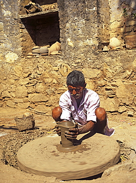 The village potter at work making water pots in Nimaj, Rajasthan, India, Asia