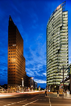 Exterior of Kollhoff Tower and Deutsche Bahn Tower at night, Potsdamer Platz, Berlin, Germany, Europe