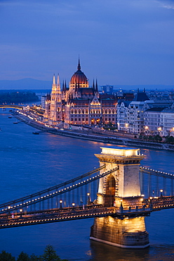 View over River Danube, Chain Bridge and Hungarian Parliament Building at night, UNESCO World Heritage Site, Budapest, Hungary, Europe