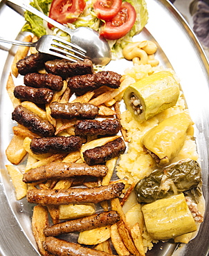 Traditional dish of cevapi and sausages, Mostar, Bosnia and Hercegovina, Europe