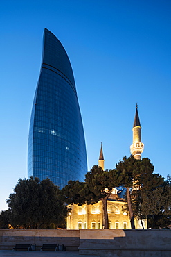 Exterior of The Shahid Mosque with Flame Towers in background at night, Baku, Azerbaijan, Central Asia, Asia