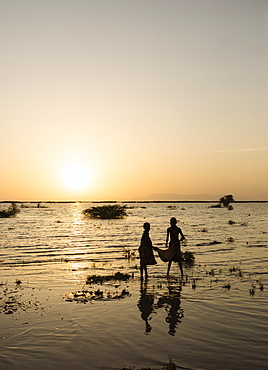 Children of the Dassanech tribe fishing on the shore of Turkana Lake, Omo Valley, Ethiopia, Africa