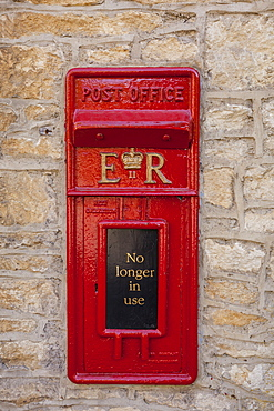 An old postbox that is no longer in use at Castle Combe in Wiltshire, England, United Kingdom, Europe
