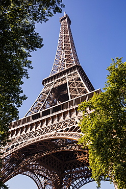 Looking up to the impressive Eiffel Tower in Paris, France, Europe