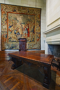 A beautifully coloured tapestry and carved wooden table in the quarters of Francois 1er, Chateau de Chambord, UNESCO World Heritage Site, Loir-et-Cher, Centre, France, Europe