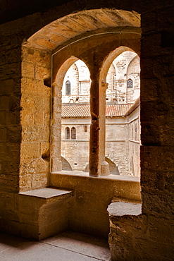 Looking through a window in the Palais de Papes, the palace home to the Sovereign Pontiffs in the 14th century, UNESCO World Heritage Site, Avignon, Vaucluse, France, Europe