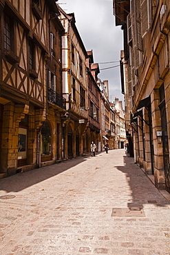 A narrow street with half timbered houses in the old city of Dijon, Burgundy, France, Europe