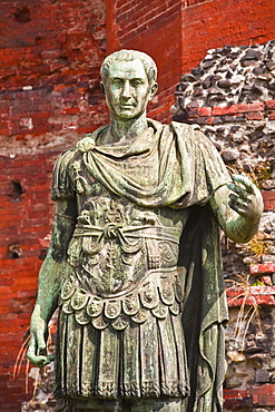 A statue of Julius Cesar in front of Porta Palatina, Turin, Piedmont, Italy, Europe