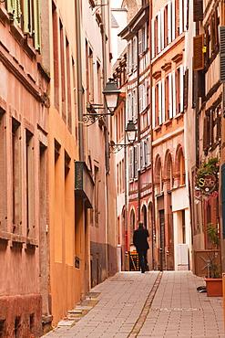 A man walks through La Petite France, Grande Ile, UNESCO World Heritage Site, Strasbourg, Bas-Rhin, Alsace, France, Europe