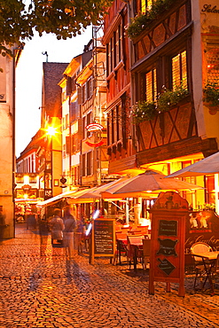 People wandering La Petite France at night, Grande Ile, UNESCO World Heritage Site, Strasbourg, Bas-Rhin, Alsace, France, Europe