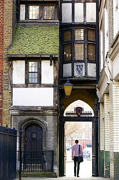 Tudor gateway to St. Bartholomew church, a timbered house from the time of Elizabeth I, West Smithfield, London, England, United Kingdom, Europe
