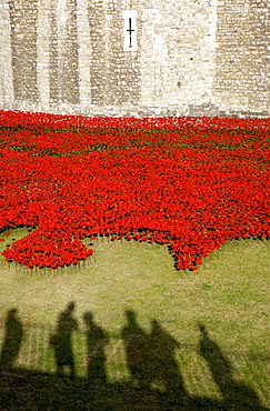 Shadows of people viewing Blood Swept Lands and Seas of Red installation at The Tower of London marking 100 years since the First World War, London, England, United Kingdom, Europe