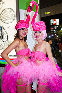 Japanese girls dressed as flamingos at thea Halloween celebrations in Shibuya, Tokyo