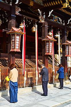 People praying at Kitano Tenmangu Shrine, Kyoto, Japan, Asia