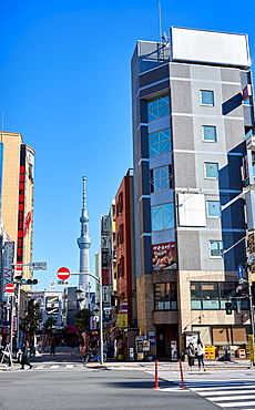 Tokyo street scene with the Sky Tree Tower in background, Tokyo, Japan, Asia