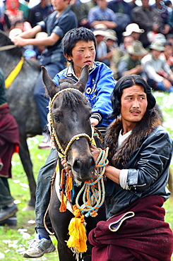 Rider getting ready for a race at the Lapste - Tibet China