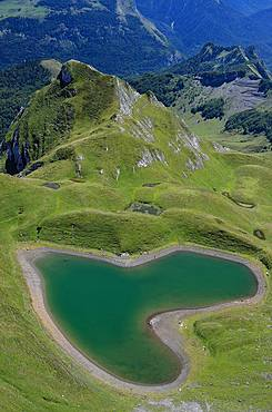 Montagnon Lake in the shape of a heart, Ossau Valley, Pyrenees, France
