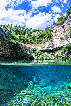 Mid-air-mid-water view of the Burles spring, karstic exsurgence of Vauclusian type, on the commune of sainte-Enimie, Lozere, Occitania, France.