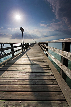 beach with pier of Wustrow sun sky with clouds Baltic sea mood Mecklenburg-Vorpommern Germany
