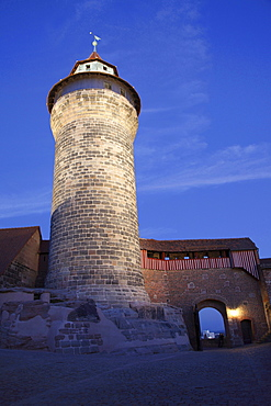 old historical castle Kaiserburg with tower illuminated at night Nuremberg francs Germany