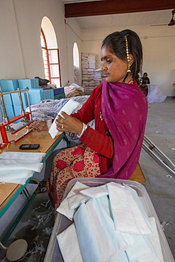 A disabled women making nappies at the Barefoot College in Tilonia, Rajasthan, India. The Barefoot College is a worldwide charity, founded by Bunker Roy, its aims are, education, drinking water, electrification through solar power, skill development, health, women empowerment and the upliftment of rural people.
