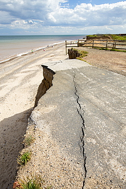 A collapsed coastal road at Easingotn on Yorkshires East Coast, near Skipsea, UK. The coast is composed of soft boulder clays, very vulnerable to coastal erosion. This sectiion of coast has been eroding since Roman times, with many villages having disappeared into the sea, and is the fastest eroding coast in Europe. Climate change is speeding up the erosion, with sea level rise, increased stormy weather and increased heavy rainfall events, all palying their part.