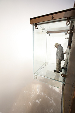 The new glass cage drop experience on the Aiguille Du Midi above Chamonix, France.