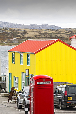 A gift shop in Port Stanley in the Falkland Islands with a British telephone box.