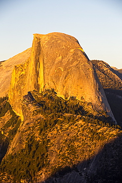 Half Dome at dusk from Glacier Point above Yosemite Valley, California, USA.