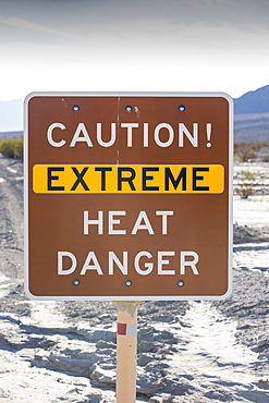 An extreme heat danger sign in Death Valley which is the lowest, hottest, driest place in the USA, with an average annual rainfall of around 2 inches, some years it does not receive any rain at all.