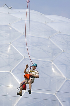 A tourist on a zip wire at the Eden Project, Cornwall, England, United Kingdom, Europe