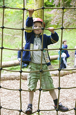 A young boy on a ropes course at Brathay in the Lake District, Cumbria, England, United Kingdom, Europe