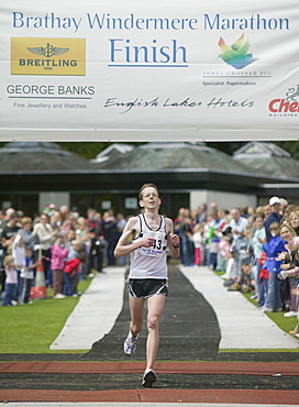 Competitors finishing the Windermere Marathon in the Lake District, Cumbria, England, United Kingdom, Europe