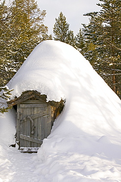 A traditional Sami house in winter in Saariselka, Northern Finland, Finland, Scandinavia, Europe