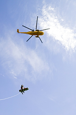 An injured climber with a dislocated shoulder is winched off Pavey Ark by the Langdale Ambleside Mountain Rescue Team and RAF Sea King helicopter, Lake District, Cumbria, England, United Kingdom, Europe