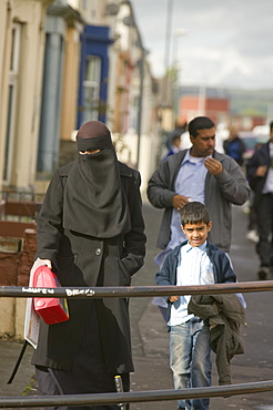A Pakistani women wearing a burkha on the streets in an Asian area of Burnley, Lancashire, England, United Kingdom, Europe