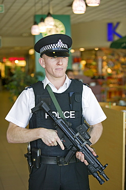 An armed police officer at Birmingham Airport, England, United Kingdom, Europe