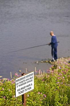 A fisherman on the River Ribble at Preston, Lancashire, England, United Kingdom, Europe