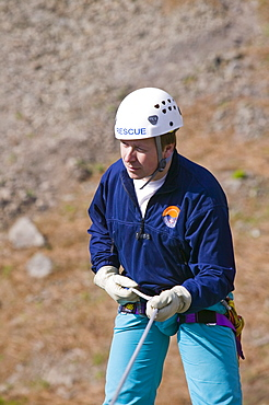 A member of Langdale Ambleside Mountin rescue team abseiling, Cumbria, England, United Kingdom, Europe