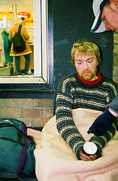 A homeless man sleeping rough and begging on the streets of Leeds, Yorkshire, England, United Kingdom, Europe