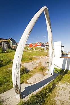 A whale bone arch and old vats for rendering down whale blubber in Ilulissat, Greenland, Polar Regions