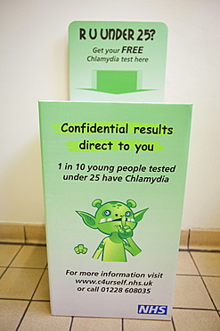 A Chlamydia self testing kit in the toilets of The University of Cumbria campus in Ambleside, Cumbria, England, United Kingdom, Europe