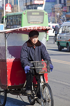 A cycle taxi on the streets of Suihua in Heilongjiang Province, Northern China, Asia