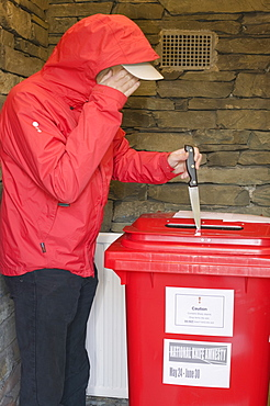 A knife amnesty with a criminal handing over a knife at a police station, Cumbria, England, United Kingdom, Europe