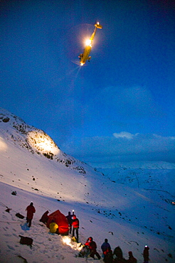 An RAF Sea King Helciopter arrives on scene as Mountain rescue team members rescue a seriously injured women from Red Screes who had fallen aorund 300 feet in the snow, Lake District, Cumbria, England, United Kingdom, Europe